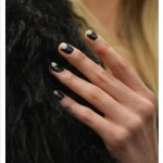 Mara Hoffman painted a reverse half-moon manicure in black and gray on her models' nails.