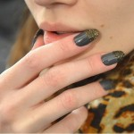 Nicholas K The nails featured a graphite-colored base accented with glitter on the tips.
