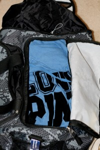 Sweater lining the bottom of gym bag.