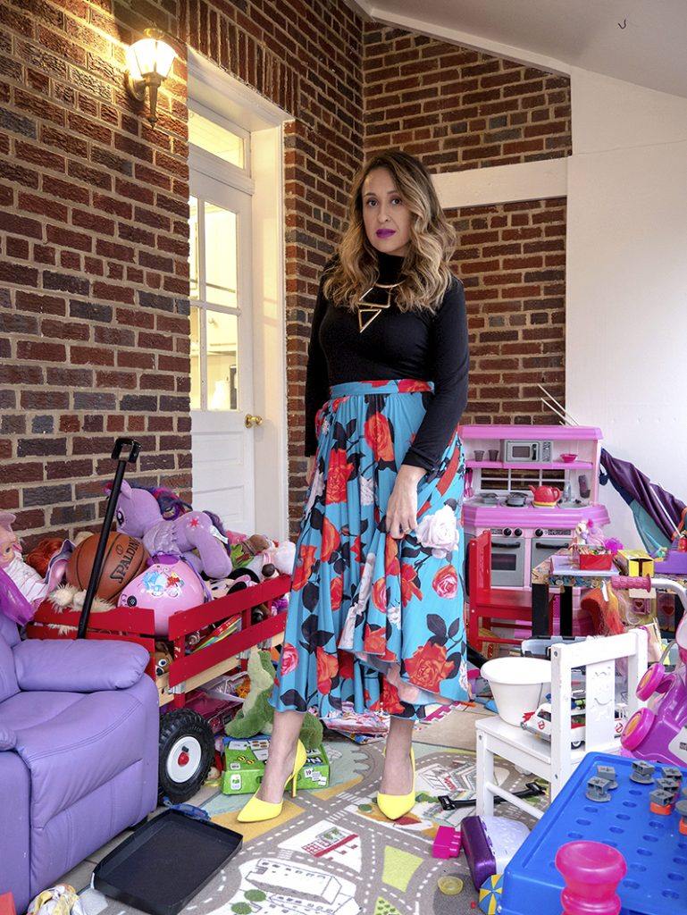 personal stylist washington DC patty chism in floral skirt in messy playroom. The millennial mom.