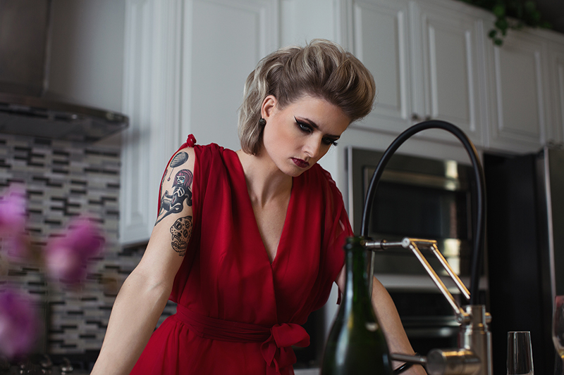 Housewife in red dress, she has broken
