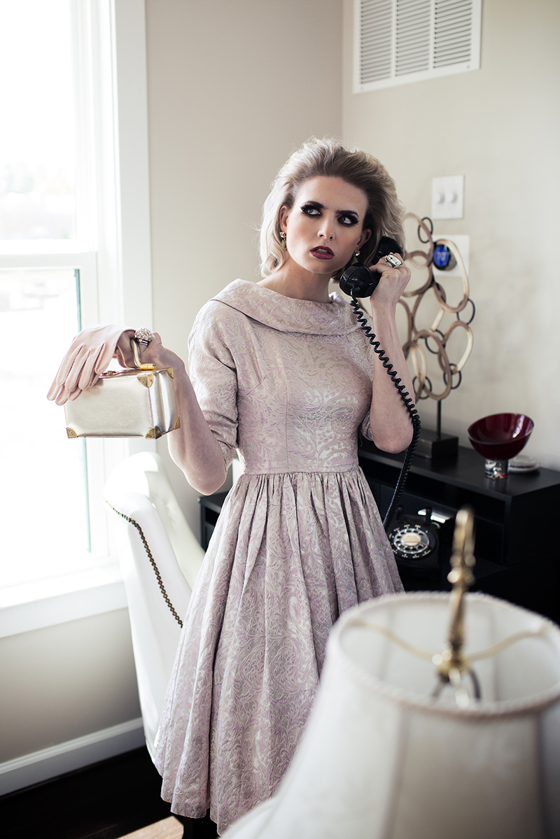Housewife in pink dress getting call from husband