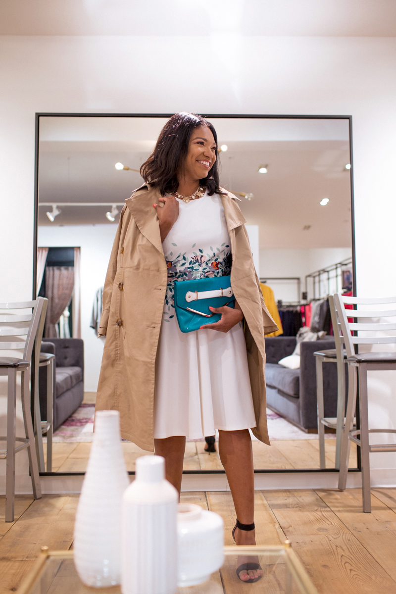 Angelica styled in the fit and flare Eloquii dress and beige trench coat.